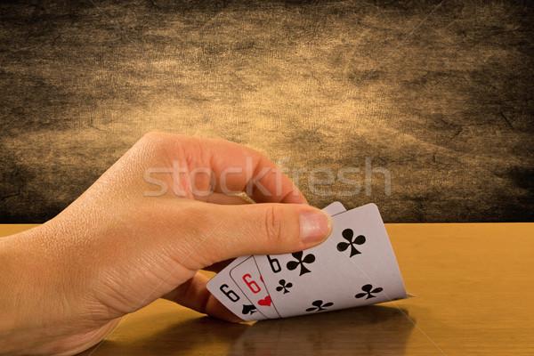 Player hand revealing triple six Stock photo © Grazvydas