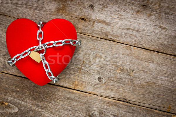 Heart with chains on wooden background Stock photo © Grazvydas