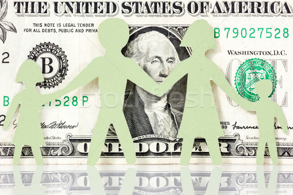 Paper family on the one dollar background Stock photo © Grazvydas