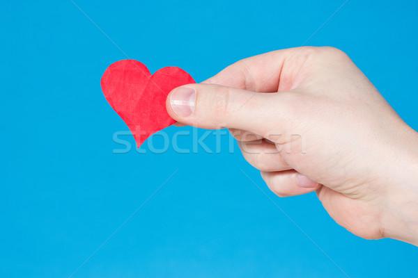 Mano corazón azul rojo papel cuerpo Foto stock © Grazvydas