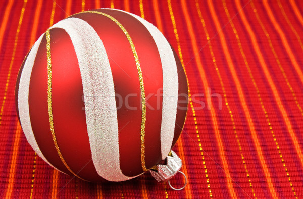 christmas bauble on red decorative background Stock photo © Grazvydas