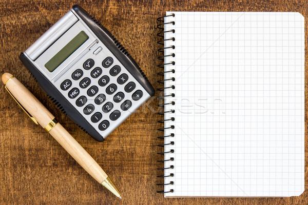ноутбук пер калькулятор бизнеса бумаги Сток-фото © Grazvydas