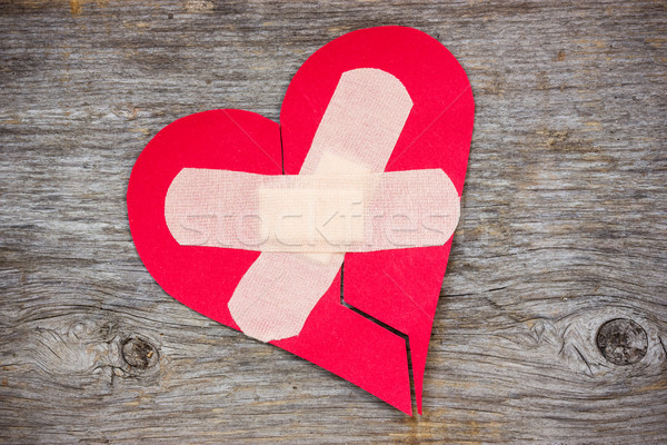 Broken heart on the wooden background Stock photo © Grazvydas