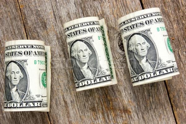 Rolled up dollar bills Stock photo © Grazvydas