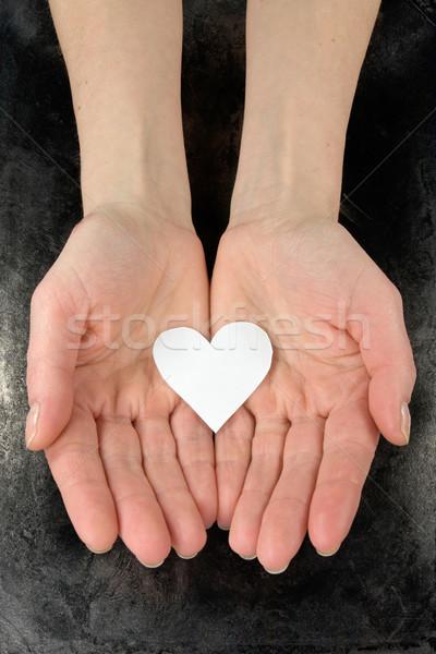 Kâğıt kalp eller yalıtılmış karanlık el Stok fotoğraf © Grazvydas