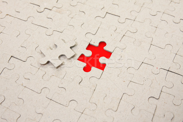 papper puzzle with  red piece missing Stock photo © Grazvydas