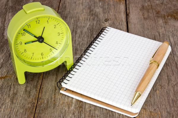 Alarm clock and blank notebook  Stock photo © Grazvydas