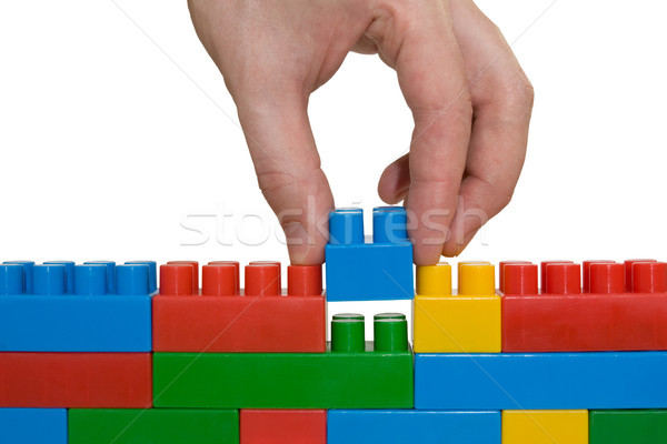 hand building up lego wall Stock photo © Grazvydas