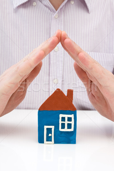 hands covering house made from plasticine Stock photo © Grazvydas