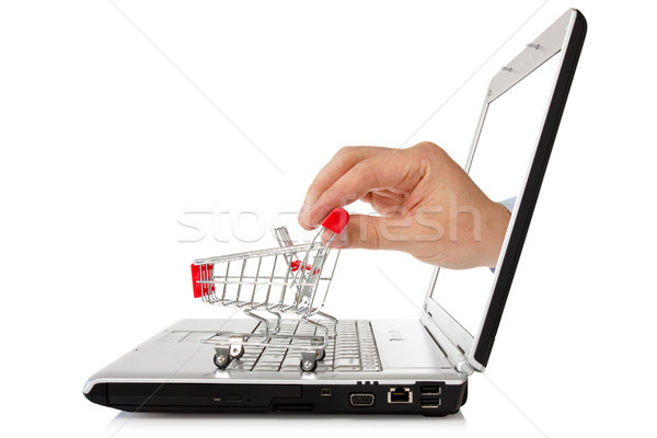 laptop and hand with shopping cart Stock photo © Grazvydas