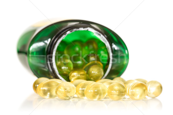 Fish oil scattering on white background Stock photo © Grazvydas