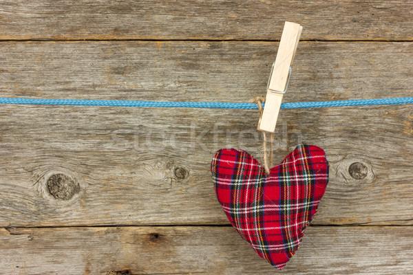 Heart hang  over a wooden background Stock photo © Grazvydas