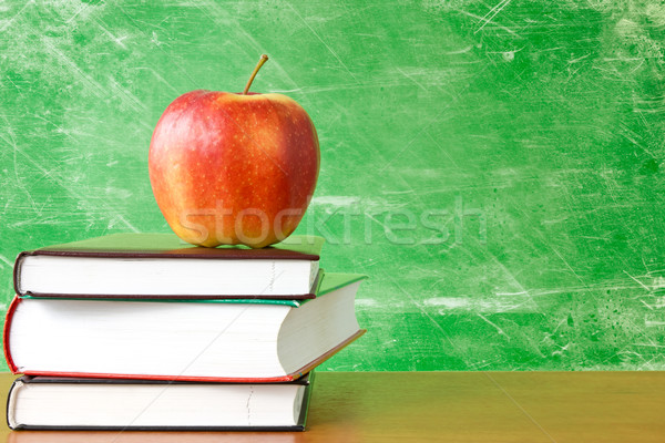 books with apple against dirty chalkboard Stock photo © Grazvydas