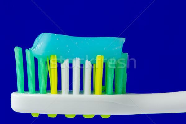 Escova de dentes creme dental isolado azul médico medicina Foto stock © Grazvydas
