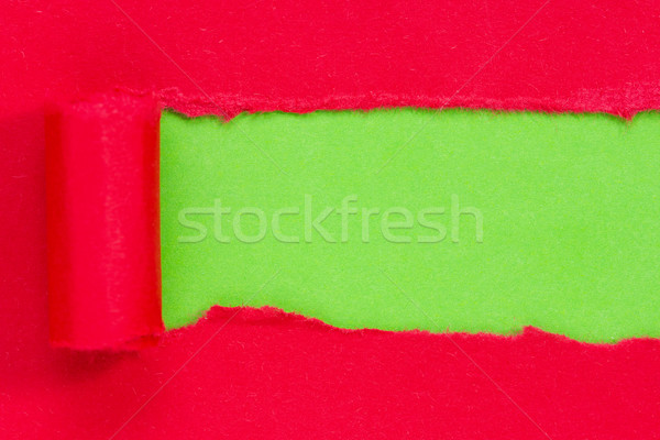 Red paper torn to reveal green panel Stock photo © Grazvydas
