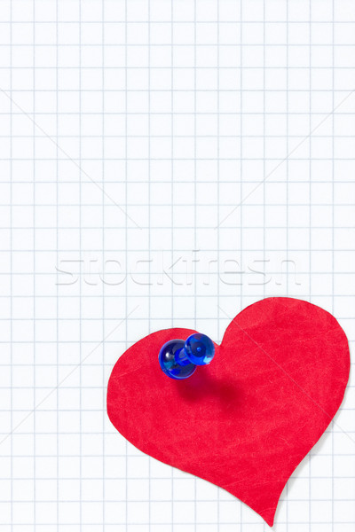 Paper heart pinned to the squared paper sheet Stock photo © Grazvydas