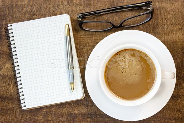 Caderno óculos xícara de café mesa de madeira negócio papel Foto stock © Grazvydas