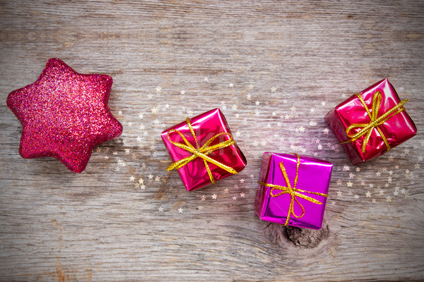 Christmas star and gifts Stock photo © Grazvydas