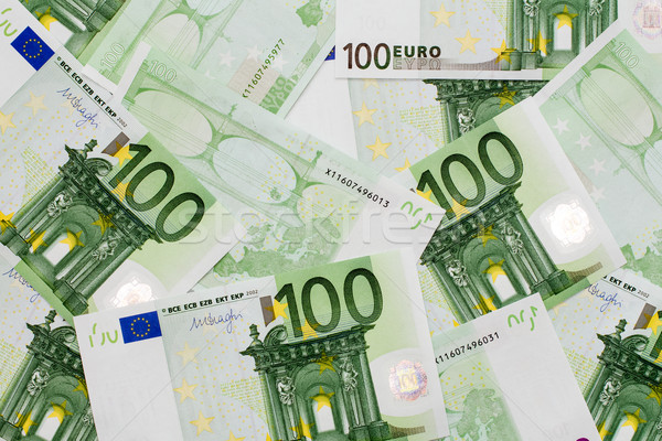 Many of one hundred euro banknotes lie side by side Stock photo © Grazvydas
