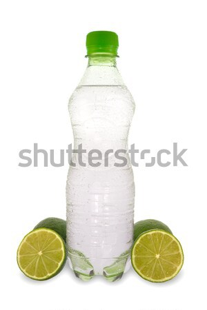 mineral water and a green lemons Stock photo © Grazvydas