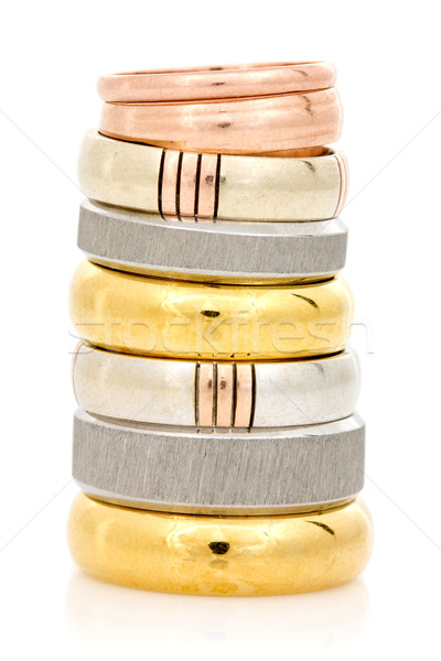 Rings stacked on a white background Stock photo © Grazvydas