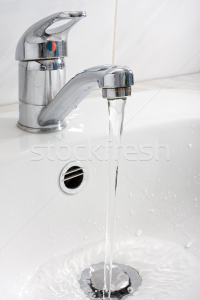 water running down from the faucet Stock photo © Grazvydas