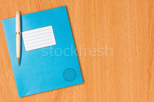 練習帳 ペン 表 青 木製のテーブル 学校 ストックフォト © Grazvydas