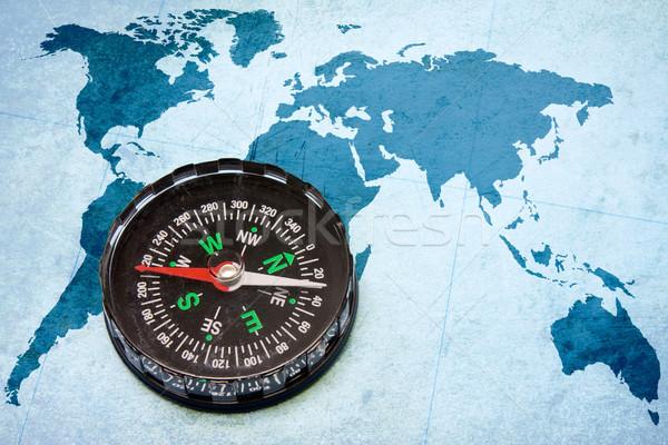 compass on the blue world map Stock photo © Grazvydas