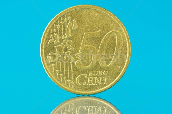 Fifty euro cent on blue background Stock photo © Grazvydas