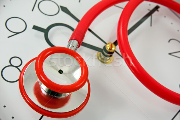 red stethoscope on the clock Stock photo © Grazvydas