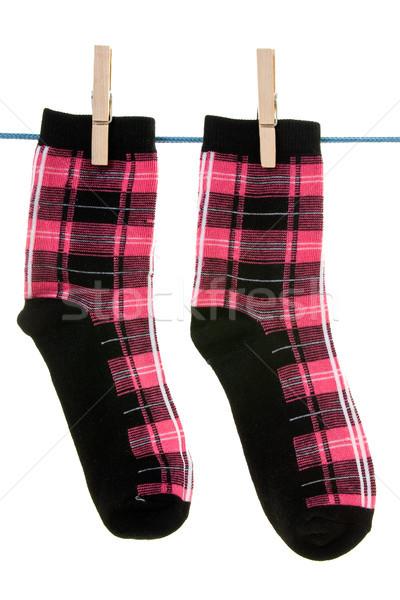 Deux chaussettes corde vêtements pied coton Photo stock © Grazvydas