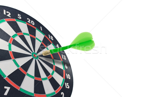 green dart hitting target center Stock photo © Grazvydas