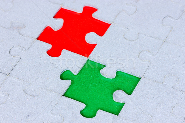 Puzzle with a green and red gap Stock photo © Grazvydas