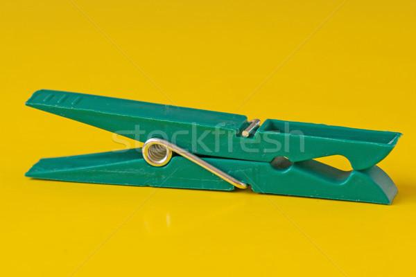 green plastic clothespin on yellow background Stock photo © Grazvydas