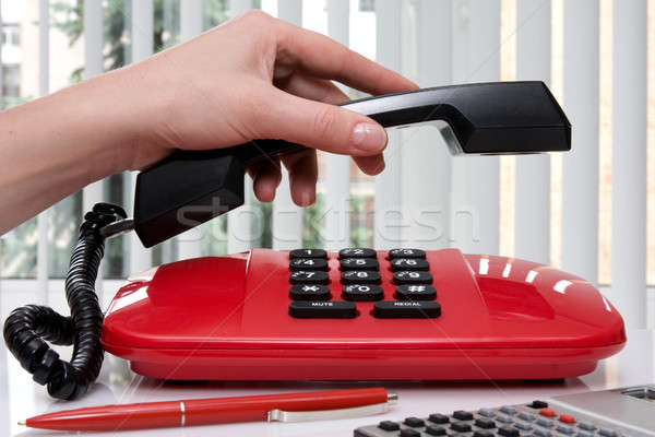 hand picking up the handset of telephone Stock photo © Grazvydas