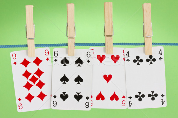 playing cards hung on clothesline Stock photo © Grazvydas