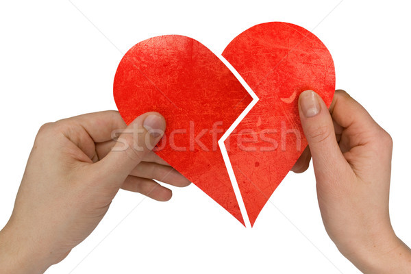 male and female holding broken heart Stock photo © Grazvydas