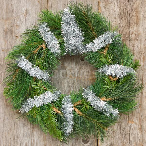 Christmas wreath hung on the wall Stock photo © Grazvydas