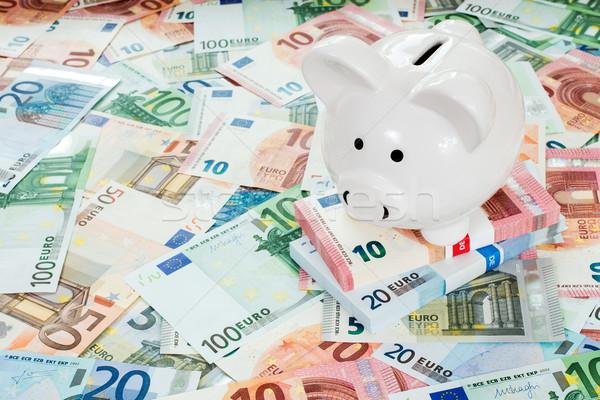 Piggy bank placed on Euro banknotes Stock photo © Grazvydas