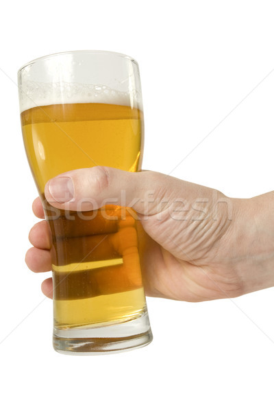 Mão completo cerveja vidro isolado branco Foto stock © Grazvydas