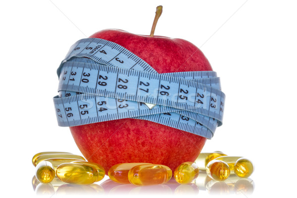 Apple and fish oil pills Stock photo © Grazvydas
