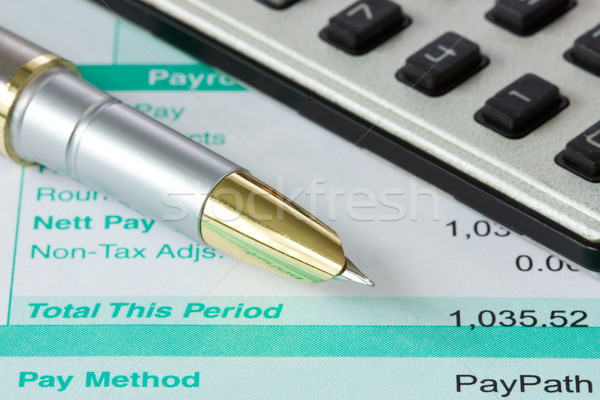 pen,calculator and payslip Stock photo © Grazvydas