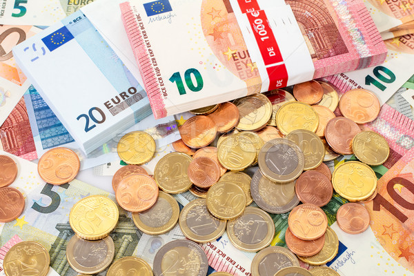 Euro (EUR) banknotes and coins  Stock photo © Grazvydas