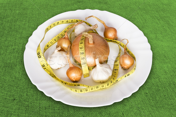 Stock photo: onions and garlics with measure tape