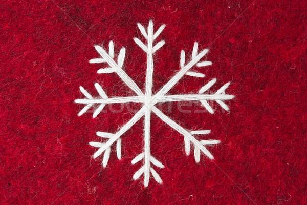 red felt with embroidered white snowflake Stock photo © Grazvydas