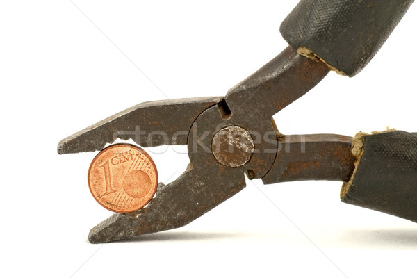 Euro cent squeezed in pliers Stock photo © Grazvydas