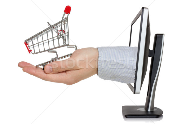 Computer monitor and hand with shopping cart  Stock photo © Grazvydas
