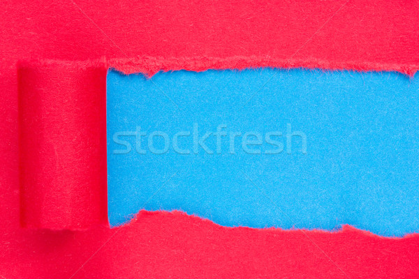 Red paper torn to reveal blue panel Stock photo © Grazvydas