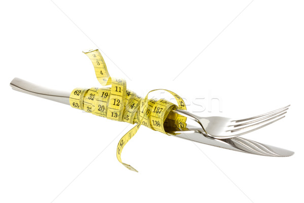 Fork and knife wrapped by measure tape Stock photo © Grazvydas