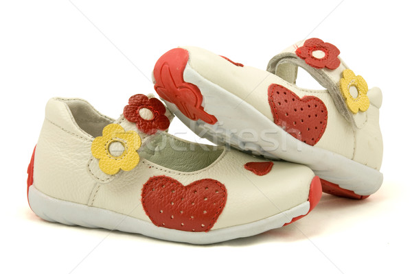 baby shoes over a white background Stock photo © Grazvydas